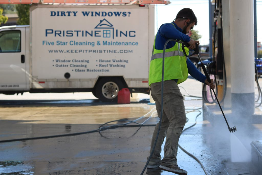 local pressure washing contractor cleaning a gas station in Baltimore County, MD
